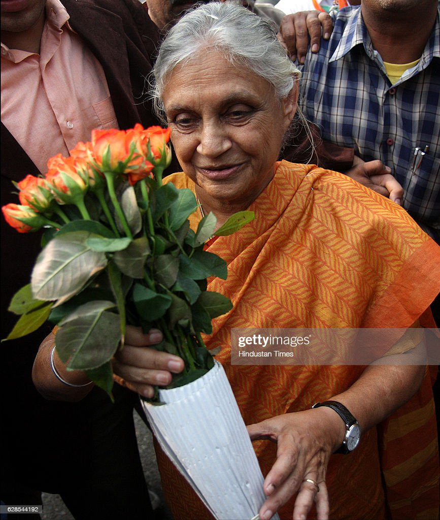Delhi Chief Minister Shiela Dikshit being presented a bouquet by a supporter at her residence in New Delhi.