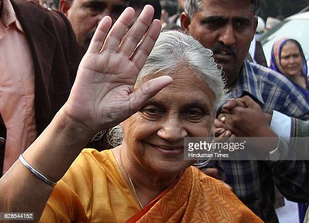 Delhi Chief Minister Shiela Dikshit waves to supporters at her residence in New Delhi