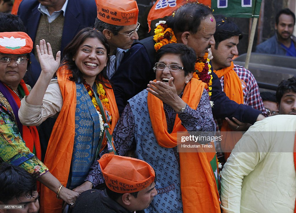 BJP Delhi Chief Ministerial candidate <a gi-track='captionPersonalityLinkClicked' href=/galleries/search?phrase=Kiran+Bedi&family=editorial&specificpeople=2886102 ng-click='$event.stopPropagation()'>Kiran Bedi</a> and BJP leader Harsh Vardhan during an election campaign rally ahead of Delhi state election on February 5, 2015 in New Delhi, India. It was last of campaigning today. The elections for the 70-member Delhi assembly will be held in a single phase on February 7. The counting of votes will take place on February 10.