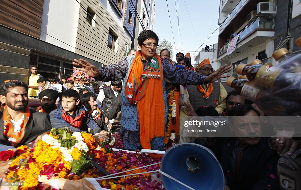 BJP Delhi Chief Ministerial candidate <a gi-track='captionPersonalityLinkClicked' href=/galleries/search?phrase=Kiran+Bedi&family=editorial&specificpeople=2886102 ng-click='$event.stopPropagation()'>Kiran Bedi</a> waves to supporters during an election campaign rally ahead of Delhi state election on February 5, 2015 in New Delhi, India. It was last of campaigning today. The elections for the 70-member Delhi assembly will be held in a single phase on February 7. The counting of votes will take place on February 10.