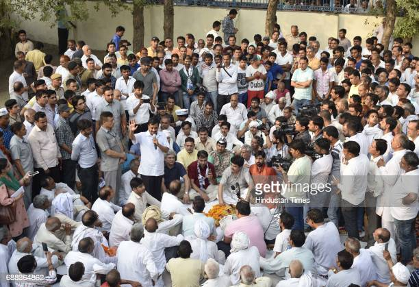 Delhi CM Arvind Kejriwal speaks to villagers of Chawala during a panchayat meeting in the Nazafgarh area on May 25 2017 in New Delhi India The...