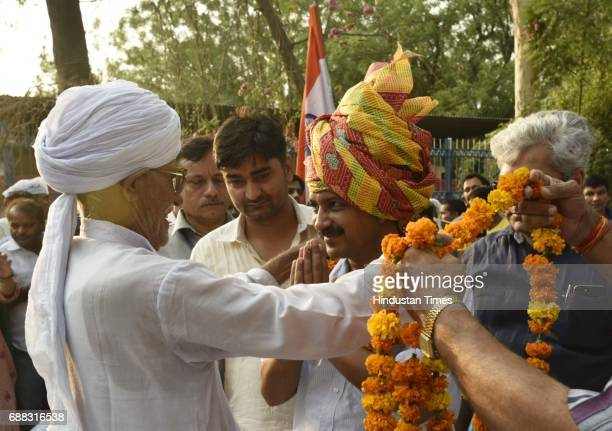 Delhi CM Arvind Kejriwal welcomed by the villagers of Chawala during a panchayat meeting in the Nazafgarh area on May 25 2017 in New Delhi India The...