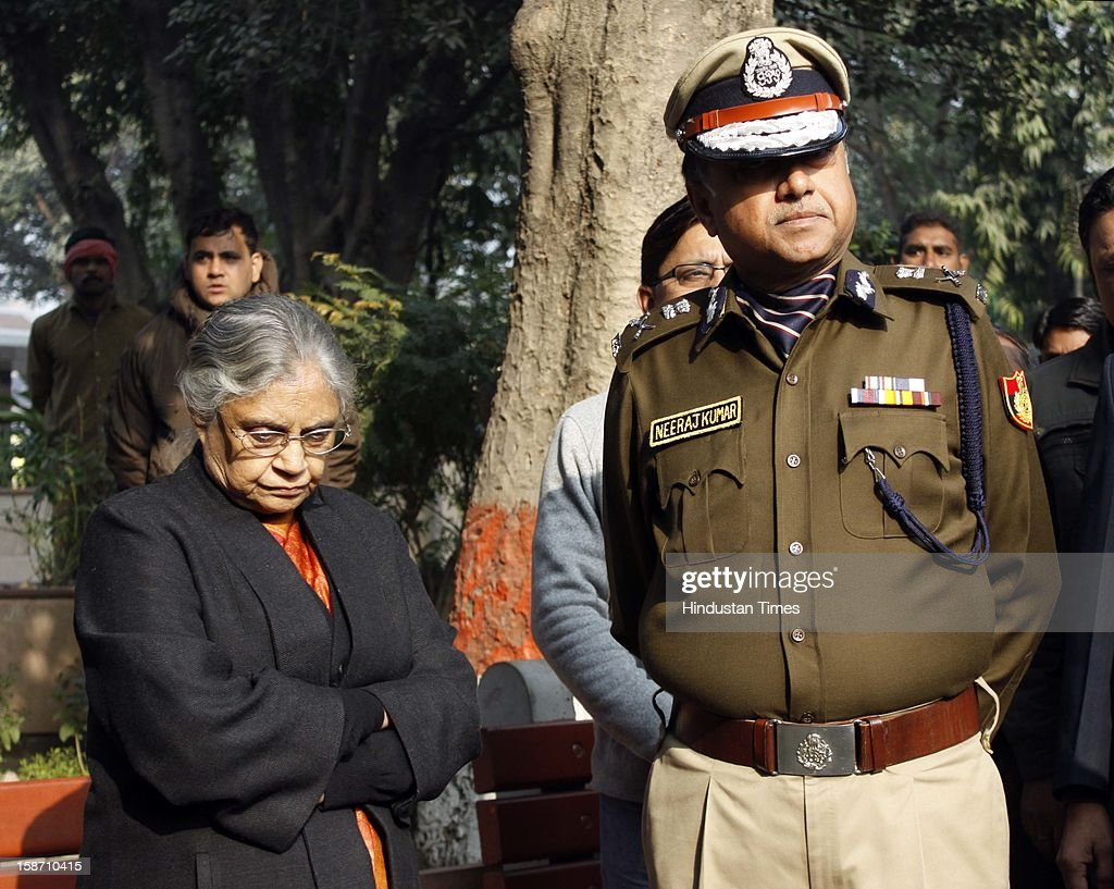 Delhi CM Sheila Dikshit and Delhi Police Commisioner Neeraj Kumar during funeral rites of Delhi Police constable Subhash Chand Tomar at Nigambodh Ghat, on December 25, 2012 in New Delhi, India. Subhash Chand died after being injured in a protest against brutal gang rape of a student in a moving bus.