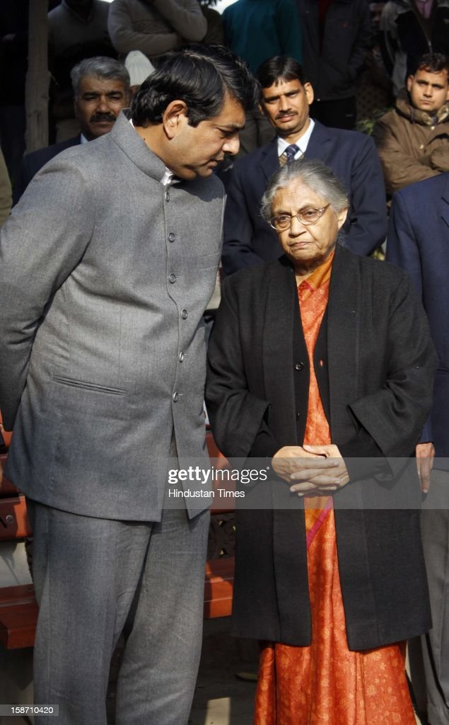 Delhi CM Sheila Dikshit and Home Secretary RK Singh during funeral rites of Delhi Police constable Subhash Chand Tomar at Nigambodh Ghat, on December 25, 2012 in New Delhi, India. Subhash Chand died after being injured in a protest against brutal gang rape of a student in a moving bus.