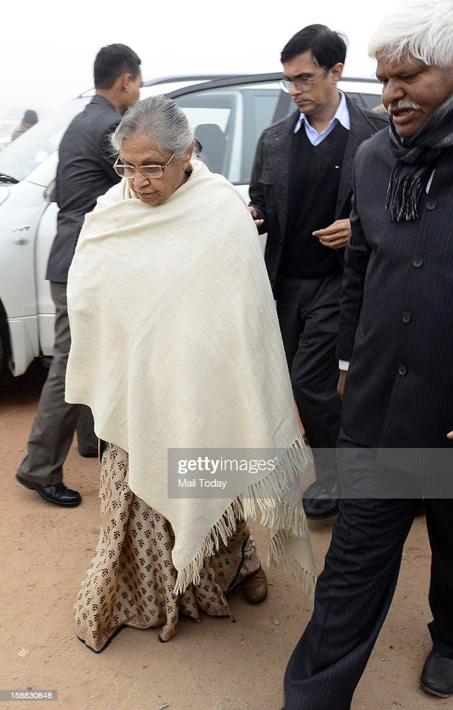 Delhi CM Sheila Dikshit arrives at a creamation ground to attend funeral of Delhi gang rape victim in Delhi on Sunday.