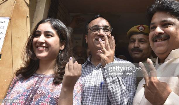 Delhi Congress Chief Ajay Maken with his daughter Arushi showing inkmarked finger after casting his vote at Rajouri Garden on April 23 2017 in New...