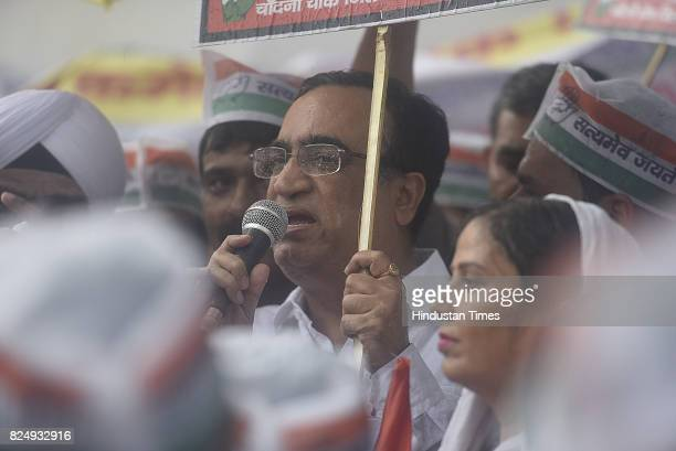 Delhi Congress leader Ajay Maken along with Trade Union and Congress workers during a protest against GST Bill at Town Hall in Chandni Chowk on July...