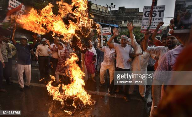 Delhi Congress Trade Union and Congress workers burn effigy of GST during a protest against GST Bill at Town Hall in Chandni Chowk on July 31 2017 in...