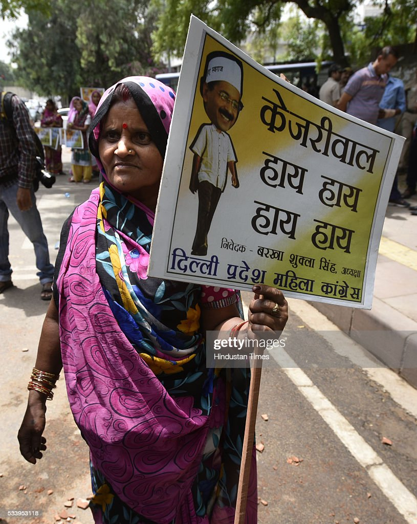 Delhi Congress women workers carry placard during a protest over water scarcity and power cuts, outside the residence of Delhi Chief Minister Arvind Kejriwal on May 24, 2016 in New Delhi, India.