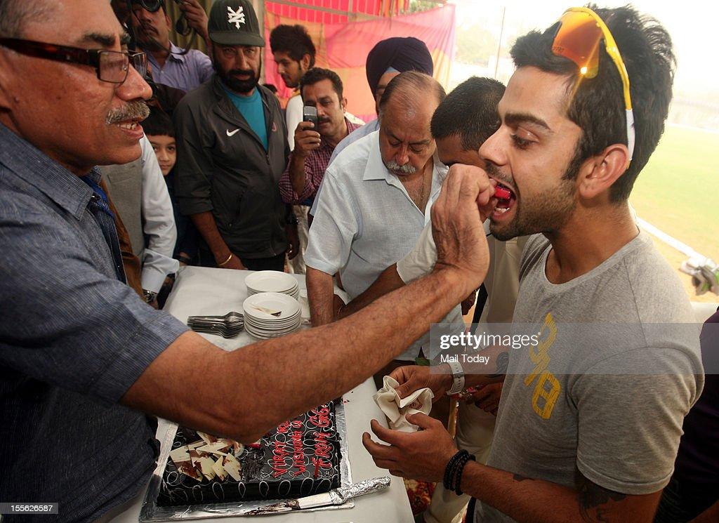 Delhi cricketer Virat Kohli celebrates his birthday in Ghaziabad during Ranji trophy match against Uttar Pradesh on Monday, 5th November 2012.
