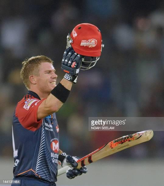 Delhi Daredevils batsman David Warner celebrates after scoring a century 100 runs during the IPL Twenty20 cricket match between the Deccan Chargers...