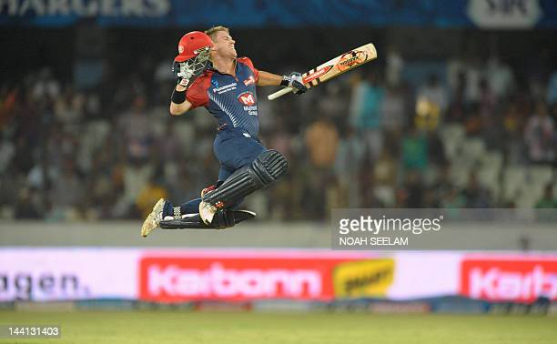 Delhi Daredevils batsman David Warner leaps in to air after scorong a century 100 runs during the IPL Twenty20 cricket match between the Deccan...