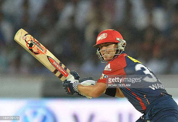 Delhi Daredevils batsman David Warner plays a shot during the IPL Twenty20 cricket match between the Deccan Chargers and Delhi Daredevils at Rajiv...