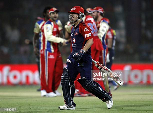 Delhi Daredevils batsman David Warner walks out after got bowled by Royal Challengers Bangalore bowler Zaheer Khan in IPL T20 match played at...