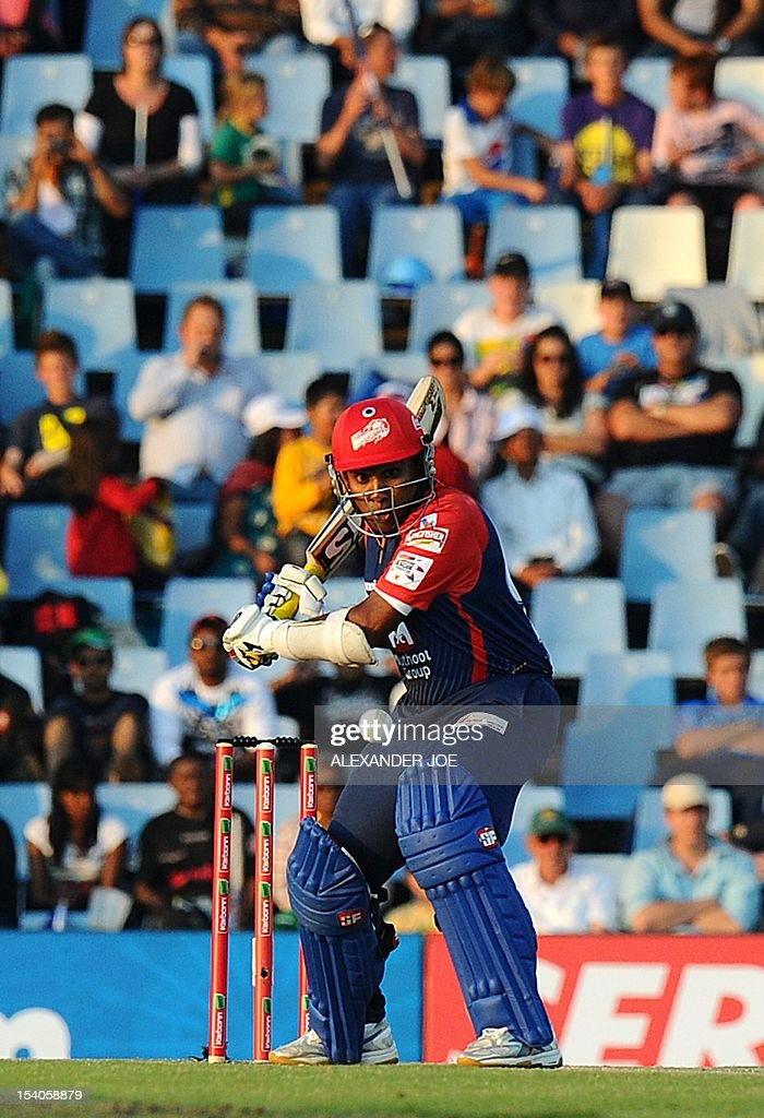 Delhi Daredevils batsman Mahela Jayawrdene (C) plays a shot from Kalkata Knight Riders bowler Brett Lee during a Group A match of The Champions League T20 (CLT20) at Super Sports Park in Centurion on October 13, 2012. Kalkata Knight Riders won the toss and elected to bowl.
