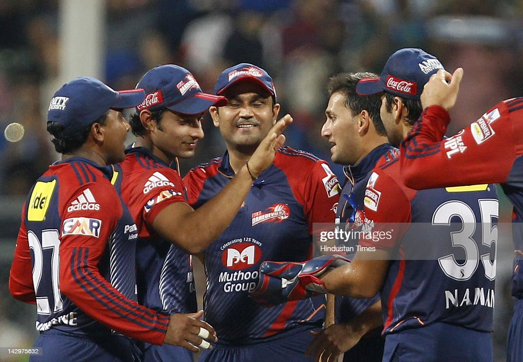 Delhi Daredevils bowler <a gi-track='captionPersonalityLinkClicked' href=/galleries/search?phrase=Ajit+Agarkar&family=editorial&specificpeople=217531 ng-click='$event.stopPropagation()'>Ajit Agarkar</a> (2nd R) celebrating with teammates after the dismissal of Mumbai Indians batsman <a gi-track='captionPersonalityLinkClicked' href=/galleries/search?phrase=Rohit+Sharma&family=editorial&specificpeople=815520 ng-click='$event.stopPropagation()'>Rohit Sharma</a> during the IPL T20 match between Mumbai Indians vs Delhi Daredevils at Wankhede Stadium on April 16, 2012 in Mumbai, India. Batting first after losing the toss Mumbai Indians posted a target of 93 to win for Delhi Daredevils.