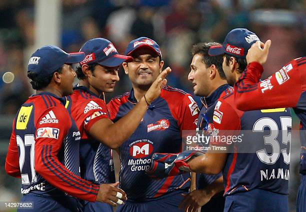 Delhi Daredevils bowler Ajit Agarkar celebrating with teammates after the dismissal of Mumbai Indians batsman Rohit Sharma during the IPL T20 match...