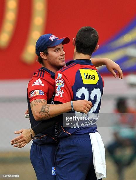 Delhi Daredevils bowler Glenn Maxwell and fielder Doug Bracewell celebrate after running out unseen Royal Challengers Bangalore batsman Daniel...