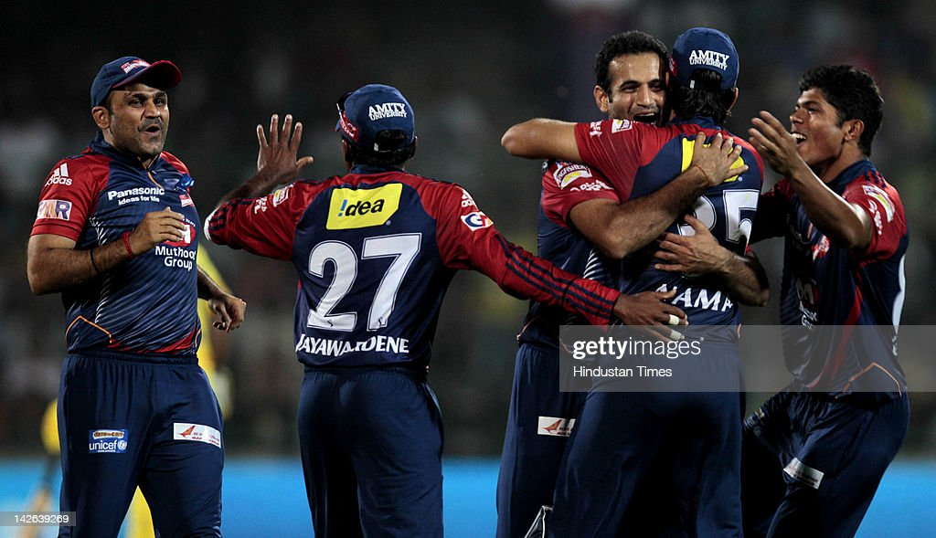Delhi Daredevils bowler <a gi-track='captionPersonalityLinkClicked' href=/galleries/search?phrase=Irfan+Pathan&family=editorial&specificpeople=217400 ng-click='$event.stopPropagation()'>Irfan Pathan</a> (C) celebrates with team-mates <a gi-track='captionPersonalityLinkClicked' href=/galleries/search?phrase=Virender+Sehwag&family=editorial&specificpeople=176591 ng-click='$event.stopPropagation()'>Virender Sehwag</a> (L) , <a gi-track='captionPersonalityLinkClicked' href=/galleries/search?phrase=Mahela+Jayawardene&family=editorial&specificpeople=213707 ng-click='$event.stopPropagation()'>Mahela Jayawardene</a> (2nd L) , Naman Ohja (2nd R) and <a gi-track='captionPersonalityLinkClicked' href=/galleries/search?phrase=Umesh+Yadav&family=editorial&specificpeople=6850849 ng-click='$event.stopPropagation()'>Umesh Yadav</a> (R) after claiming the wicket of Chennai Super Kings batsman Ravindra Jadeja during the IPL 5 cricket match between Delhi Daredevils and Chennai Super Kings at Ferozshah Kotla Ground on April 10, 2012 in New Delhi, India. Batting first after losing the toss Chennai Super Kings posted a target of 111 runs to win for Delhi Daredevils.