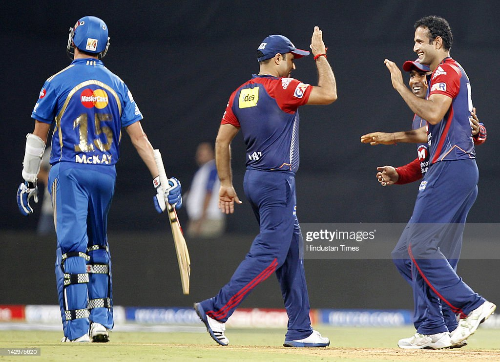 Delhi Daredevils bowler <a gi-track='captionPersonalityLinkClicked' href=/galleries/search?phrase=Irfan+Pathan&family=editorial&specificpeople=217400 ng-click='$event.stopPropagation()'>Irfan Pathan</a> (R) celebrating with teammates <a gi-track='captionPersonalityLinkClicked' href=/galleries/search?phrase=Virender+Sehwag&family=editorial&specificpeople=176591 ng-click='$event.stopPropagation()'>Virender Sehwag</a> (2nd L)and <a gi-track='captionPersonalityLinkClicked' href=/galleries/search?phrase=Mahela+Jayawardene&family=editorial&specificpeople=213707 ng-click='$event.stopPropagation()'>Mahela Jayawardene</a> (2nd R) after the dismissal of Mumbai Indians batsman Clint McKay (L) during the IPL T20 match between Mumbai Indians vs Delhi Daredevils at Wankhede Stadium on April 16, 2012 in Mumbai, India. Batting first after losing the toss Mumbai Indians posted a target of 93 to win for Delhi Daredevils.