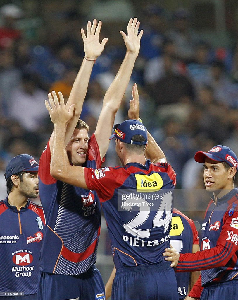 Delhi Daredevils bowler <a gi-track='captionPersonalityLinkClicked' href=/galleries/search?phrase=Morne+Morkel&family=editorial&specificpeople=4064354 ng-click='$event.stopPropagation()'>Morne Morkel</a> (2 L) celebrating with teammates Kevin Peterson (C) and <a gi-track='captionPersonalityLinkClicked' href=/galleries/search?phrase=Ross+Taylor&family=editorial&specificpeople=845922 ng-click='$event.stopPropagation()'>Ross Taylor</a> (R) after the dismissal of Mumbai Indians batsman Rudra Pratap Singh during the IPL T20 match between Mumbai Indians vs Delhi Daredevils at Wankhede Stadium on April 16, 2012 in Mumbai, India. Batting first after losing the toss Mumbai Indians posted a target of 93 to win for Delhi Daredevils.