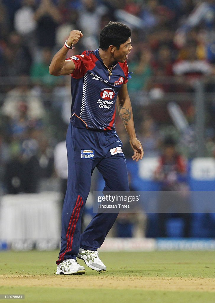 Delhi Daredevils bowler <a gi-track='captionPersonalityLinkClicked' href=/galleries/search?phrase=Umesh+Yadav&family=editorial&specificpeople=6850849 ng-click='$event.stopPropagation()'>Umesh Yadav</a> celebrating after the dismissal of Mumbai Indians batsman Keiron Pollard during the IPL T20 match between Mumbai Indians vs Delhi Daredevils at Wankhede Stadium on April 16, 2012 in Mumbai, India. Batting first after losing the toss Mumbai Indians posted a target of 93 to win for Delhi Daredevils.