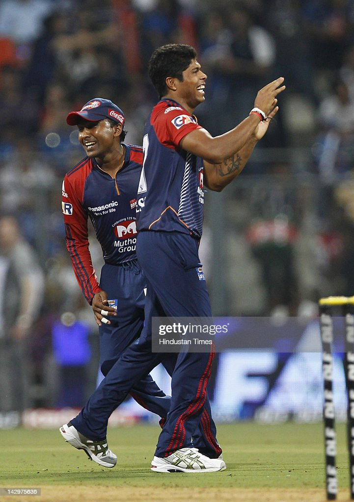 Delhi Daredevils bowler <a gi-track='captionPersonalityLinkClicked' href=/galleries/search?phrase=Umesh+Yadav&family=editorial&specificpeople=6850849 ng-click='$event.stopPropagation()'>Umesh Yadav</a> celebrating after the dismissal of Mumbai Indians batsman Dinesh Karthik during the IPL T20 match between Mumbai Indians vs Delhi Daredevils at Wankhede Stadium on April 16, 2012 in Mumbai, India. Batting first after losing the toss Mumbai Indians posted a target of 93 to win for Delhi Daredevils.