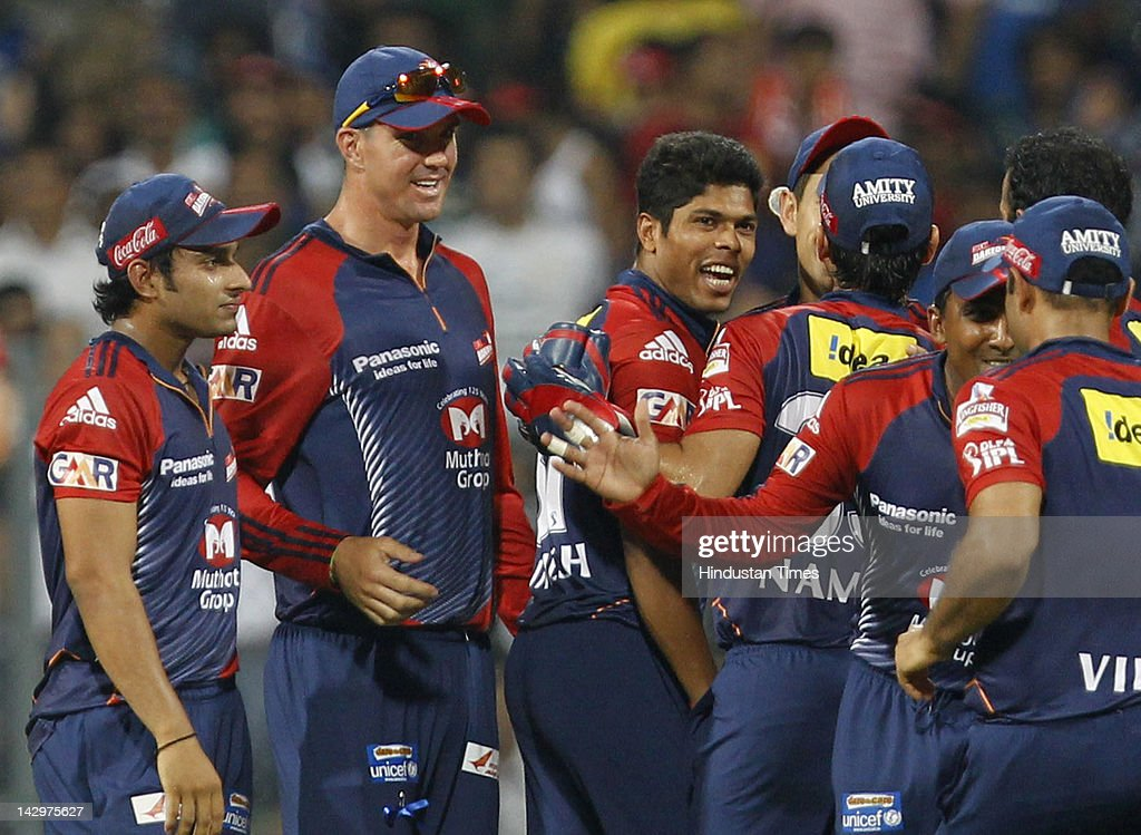 Delhi Daredevils bowler <a gi-track='captionPersonalityLinkClicked' href=/galleries/search?phrase=Umesh+Yadav&family=editorial&specificpeople=6850849 ng-click='$event.stopPropagation()'>Umesh Yadav</a> (3rd L) celebrating with his teammates after the dismissal of Mumbai Indians batsman Keiron Pollard during the IPL T20 match between Mumbai Indians vs Delhi Daredevils at Wankhede Stadium on April 16, 2012 in Mumbai, India. Batting first after losing the toss Mumbai Indians posted a target of 93 to win for Delhi Daredevils.