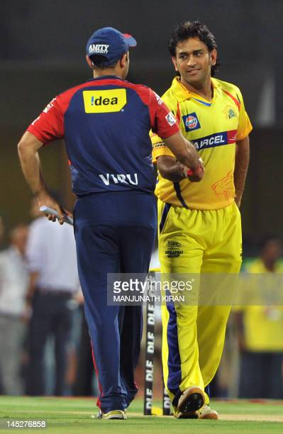 Delhi Daredevils captain Virender Sehwag shakes hands with Chennai Super Kings captain MS Dhoni after Delhi Daredevils won the toss and elected to...