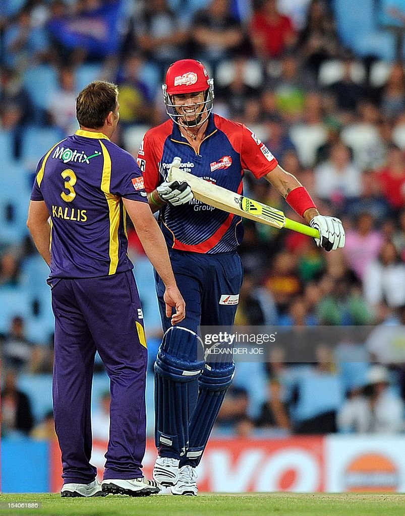 Delhi Daredevils cricketer Kevian Pietersen jokes with Kalkata Knight Riders Jacques Kallis during Group A of he Champions League T20 (CLT20) at Super Sports Park in Centurion on October 13, 2012. Kalkata Knight Riders won the toss and elected to bowl.