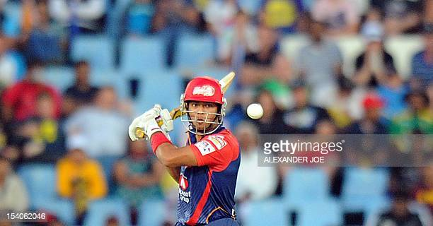 Delhi Daredevils cricketer Unmukt Chand plays a shot from Kalkata Knight Riders bowler Pradeep Sangwan during Group A match of The Champions League...