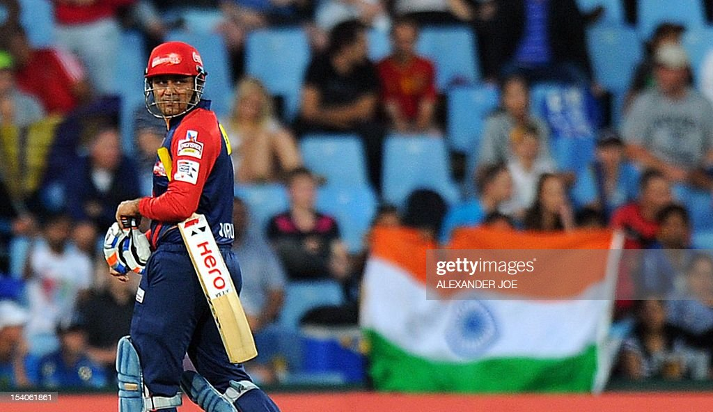 Delhi Daredevils cricketer Virender Sehwag walks back to the pavillion for 22 runs during Group A of The Champions League T20 (CLT20) at Super Sports Park in Centurion on October 13, 2012. Kalkata Knight Riders won the toss and elected to bowl.