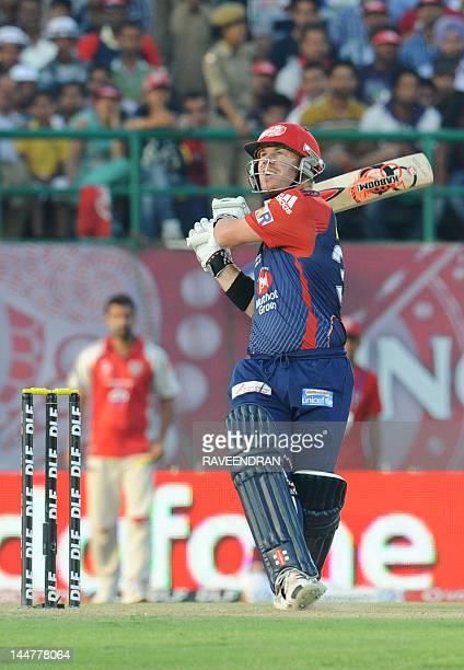 Delhi Daredevils player David Warner play a shot during the IPL Twenty20 cricket match between Kings XI Punjab and Delhi Daredevils at the Himachal...