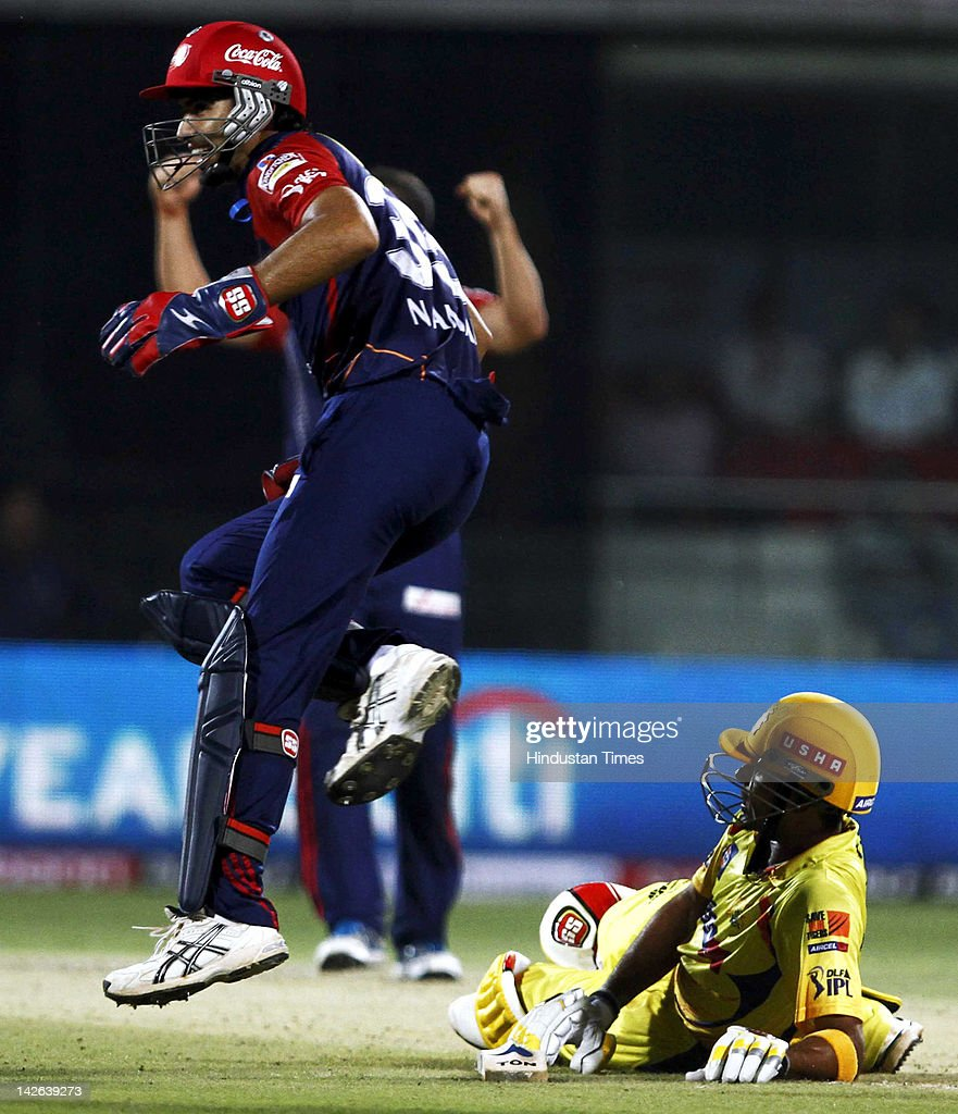 Delhi Daredevils player Naman Ojha celebrates after getting Chennai Super Kings batsman Subramaniam Badrinath (R) runout during the IPL 5 cricket match between Delhi Daredevils and Chennai Super Kings at Ferozshah Kotla Ground on April 10, 2012 in New Delhi, India. Batting first after losing the toss Chennai Super Kings posted a target of 111 runs to win for Delhi Daredevils.