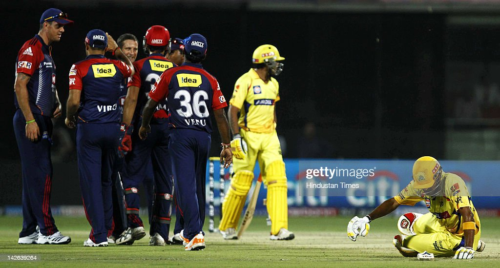 Delhi Daredevils players celebrate the wicket of Chennai Super Kings batsman <a gi-track='captionPersonalityLinkClicked' href=/galleries/search?phrase=Subramaniam+Badrinath&family=editorial&specificpeople=4444609 ng-click='$event.stopPropagation()'>Subramaniam Badrinath</a> (R) after he was run out during the IPL 5 cricket match between Delhi Daredevils and Chennai Super Kings at Ferozshah Kotla Ground on April 10, 2012 in New Delhi, India. Batting first after losing the toss Chennai Super Kings posted a target of 111 runs to win for Delhi Daredevils.