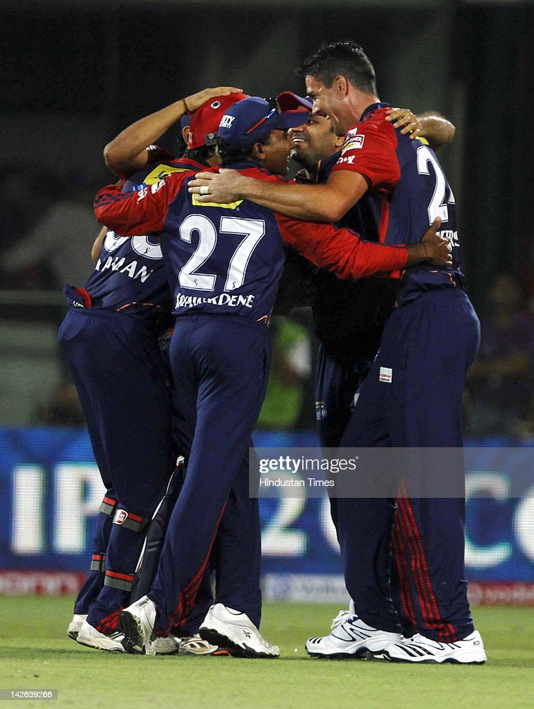 Delhi Daredevils players, including <a gi-track='captionPersonalityLinkClicked' href=/galleries/search?phrase=Kevin+Pietersen+-+Cricket+Player&family=editorial&specificpeople=202001 ng-click='$event.stopPropagation()'>Kevin Pietersen</a> (R), celebrate claiming the wicket of Chennai Super Kings batsman Suresh Raina (not pictured) after he was run out during the IPL 5 cricket match between Delhi Daredevils and Chennai Super Kings at Ferozshah Kotla Ground on April 10, 2012 in New Delhi, India. Batting first after losing the toss Chennai Super Kings posted a target of 111 runs to win for Delhi Daredevils.