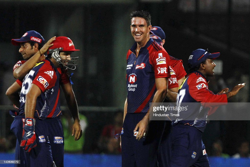 Delhi Daredevils players, including <a gi-track='captionPersonalityLinkClicked' href=/galleries/search?phrase=Kevin+Pietersen+-+Cricket+Player&family=editorial&specificpeople=202001 ng-click='$event.stopPropagation()'>Kevin Pietersen</a> (C), celebrate claiming the wicket of Chennai Super Kings batsman Suresh Raina (not pictured) after he was run out during the IPL 5 cricket match between Delhi Daredevils and Chennai Super Kings at Ferozshah Kotla Ground on April 10, 2012 in New Delhi, India. Batting first after losing the toss Chennai Super Kings posted a target of 111 runs to win for Delhi Daredevils.