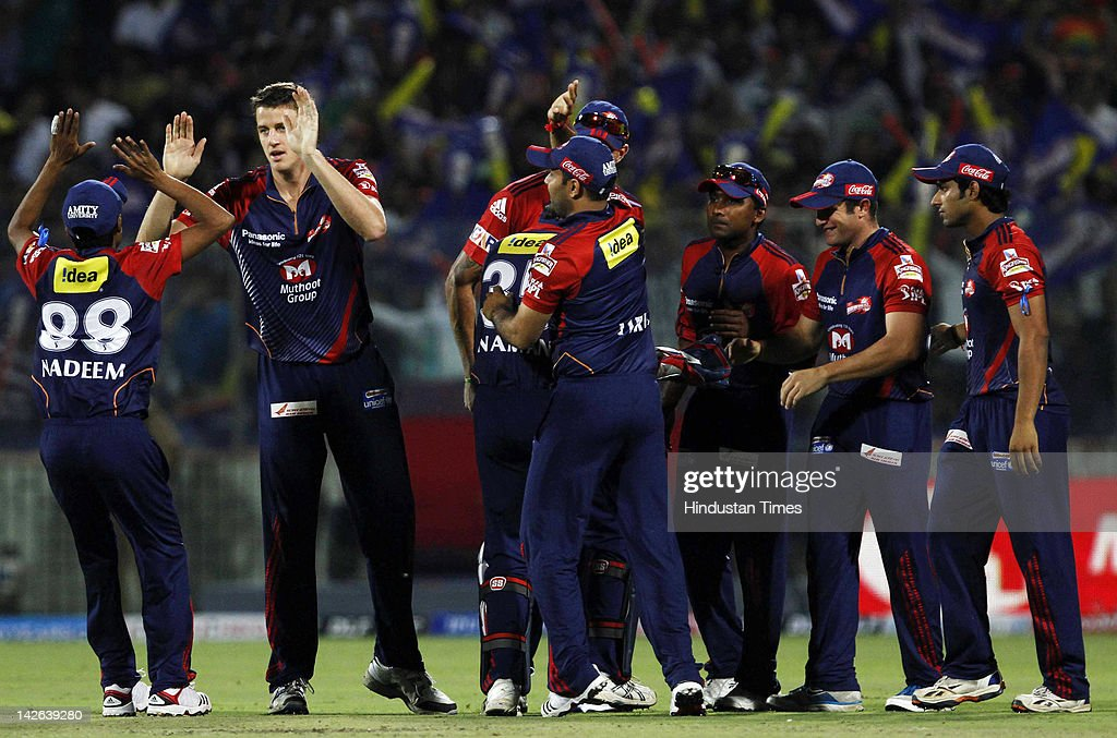 Delhi Daredevils players, including <a gi-track='captionPersonalityLinkClicked' href=/galleries/search?phrase=Morne+Morkel&family=editorial&specificpeople=4064354 ng-click='$event.stopPropagation()'>Morne Morkel</a> (2nd L), celebrate the wicket of Chennai Super Kings batsman Suresh Raina (not pictured) after he was run out during the IPL 5 cricket match between Delhi Daredevils and Chennai Super Kings at Ferozshah Kotla Ground on April 10, 2012 in New Delhi, India. Batting first after losing the toss Chennai Super Kings posted a target of 111 runs to win for Delhi Daredevils.