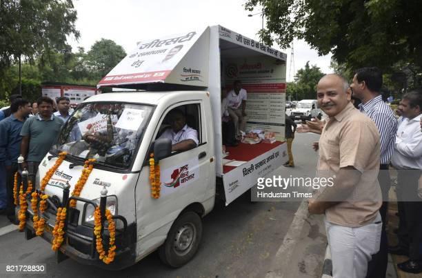 Delhi Deputy Chief Minister Manish Sisodia flags off the GST awareness mobile vans at Gate no 6 Delhi Secretariat on July 24 2017 in New Delhi India