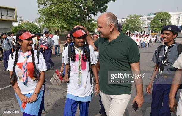 Delhi Deputy Chief Minister Manish Sissodia participates in a rally on World Menstrual Day at Connaught Place on May 28 2017 in New Delhi India...