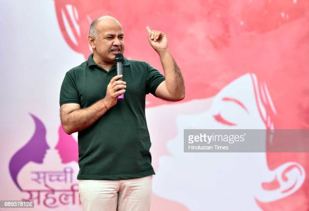 Delhi Deputy Chief Minister Manish Sisodia participates in a rally on World Menstrual Day at Connaught Place on May 28 2017 in New Delhi India...