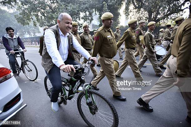 Delhi Deputy Chief Minister Manish Sisodia rides his bicycle while heading towards the AIR office as the capital continued trying out its traffic...