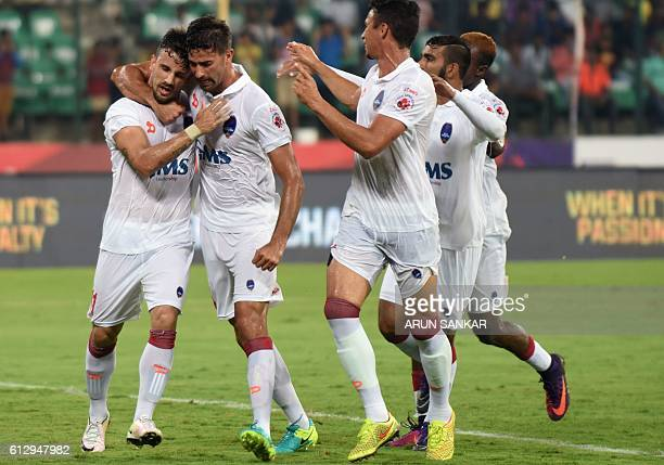 Delhi Dyanamos FC forward Marcelo Leite Pereira celebrates along with his teammates after scoring a goal against Chennaiyin FC during the Indian...