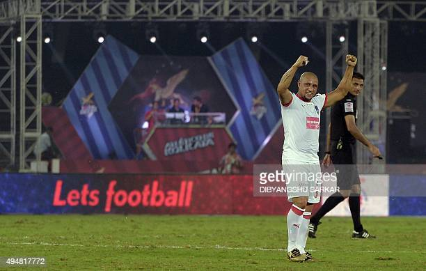 Delhi Dynamo FC's defender Roberto Carlos celebrates after his team won the Indian Super League football match between and AtleticodeKolkata and...