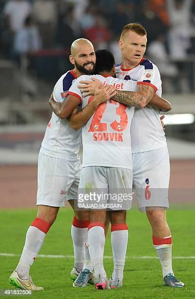 Delhi Dynamos FC Dutch midfielder Hans Mulder Indian midfielder Souvik Chakraborty and Norwegian defender John Arne Riise celebrate after winning...