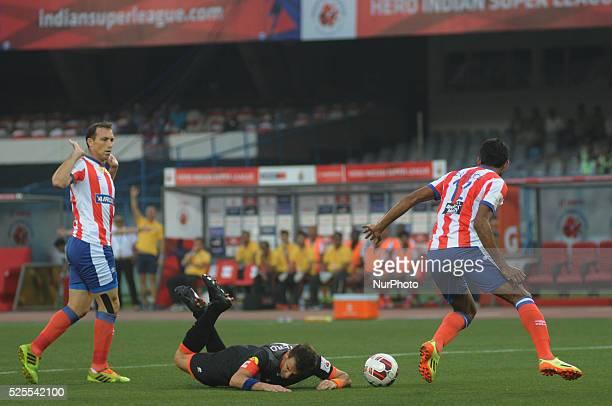 Delhi Dynamos FC footballer Alessandro Del Piero attempts to negotiate past Atletico de Kolkata footballer Jose Miguel Rey while Arnab Mandal looks...