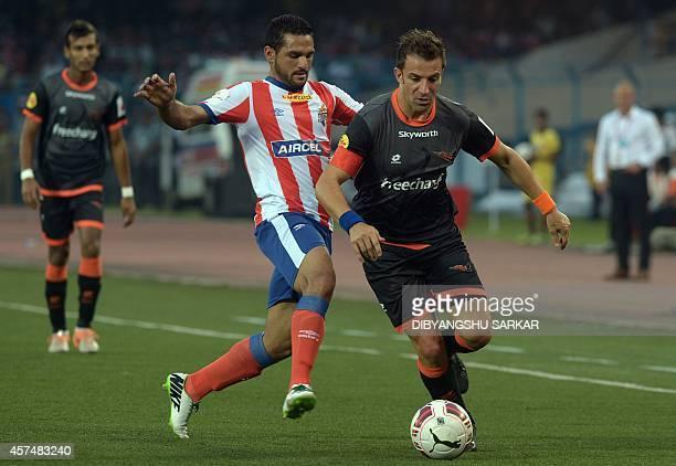 Delhi Dynamos FC footballer Alessandro Del Piero in action with Atletico de Kolkata footballer Baljit Saini during the Indian Super League football...