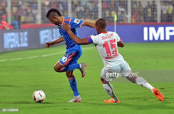 Delhi Dynamos FC French midfielder Florent Malouda tackles FC Goa player Brazilian midfielder Leonardo da Silva Moura during the second leg of the...