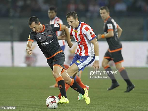 Delhi Dynamos FC player in action defending the Atletico De Kolkata during ISL match at The Salt Lake Stadium Kolkata India on Sunday October 19 2014...