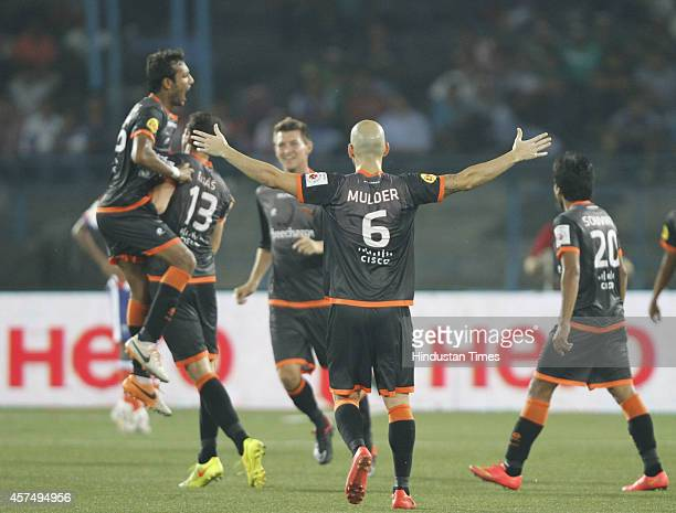 Delhi Dynamos FC players celebrate after scoring a goal during the Indian Super League football match between Atletico de Kolkata and Delhi Dynamos...